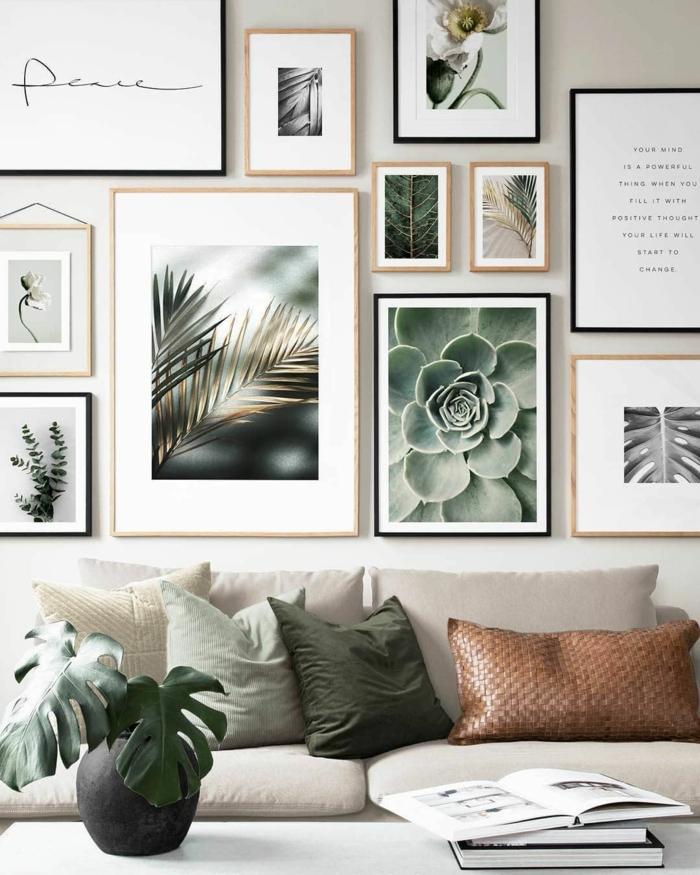 Dekoration von Wand mit Bilder mit Naturmotiven, Bilder mit Rahmen, cremefarbener Sofa mit Kissen in grün und braun