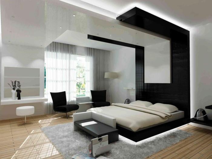 schlafzimmer-einrichten-beispiele-schwarzer-akzent-hinter-dem-bett