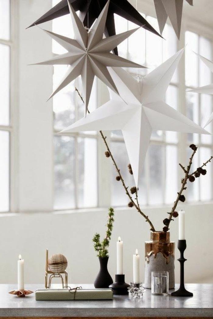skandinavisches-Interieur-Winter-Gestaltung-dekorative-Sterne-aus-Papier-weiche-Nuancen