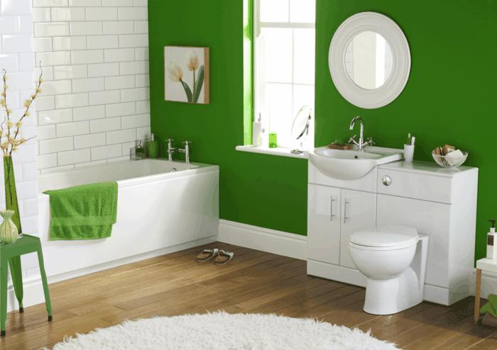 stilvolles-Badezimmer-grüne-Wand-runder-Spiegel-eleganter-Unterschrank-grünes-Tuch-Wandbild-weiße-Tulpen-Darstellung