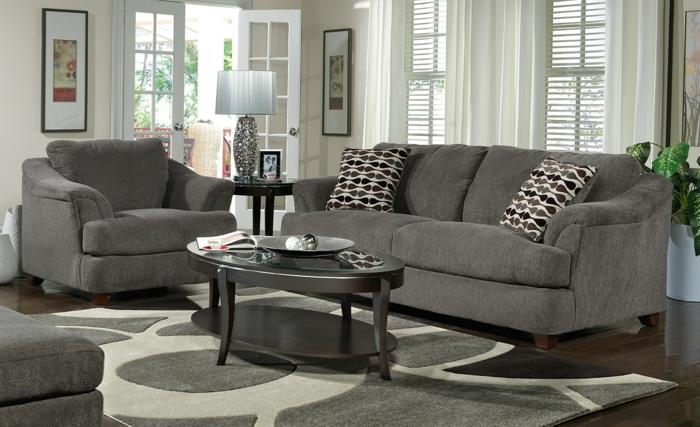 Couchtisch-oval-grau-teppich-grau-sofa