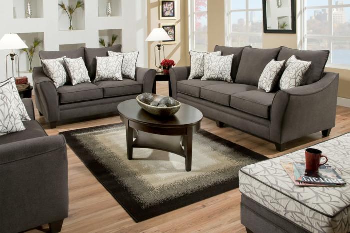 Couchtisch-oval-im-wohnzimmer-graue-gestaltung