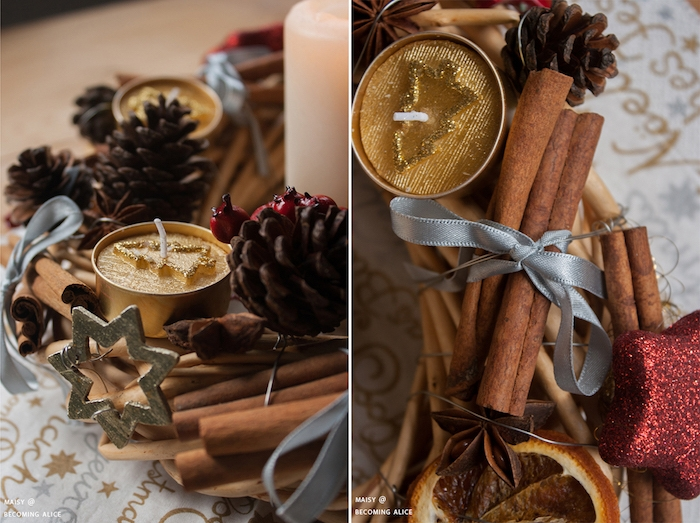 DIY Adventskranz Idee, vier goldene Teelichter mit Glitzer, kleine Tannenzapfen, getrocknete Orangenscheiben und Zimt