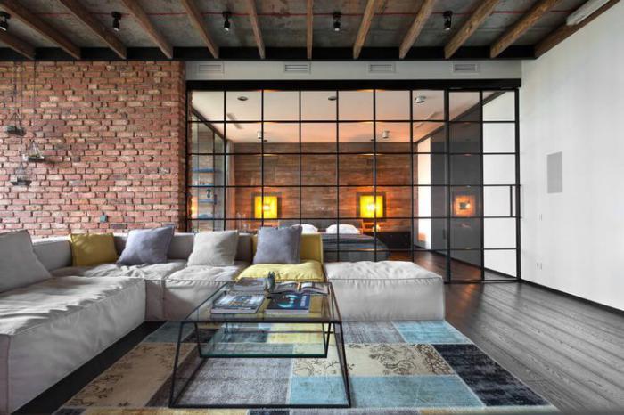räumliches-Wohnzimmer-Ziegelwände-Patchwork-Teppich