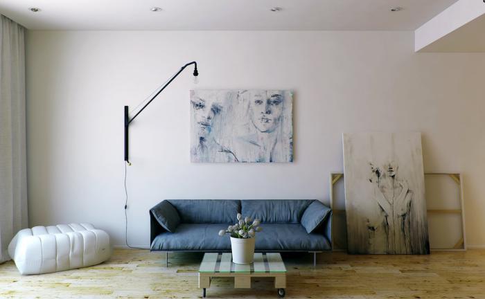 artistisches-Interieur-avantgarde-Bilder-weißer-Couchtisch-mit-Rollen