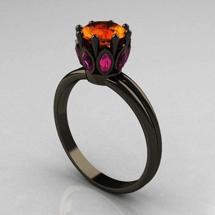 ausgefallene-Ringe-schwarzer-Gold-Saphir-Steine-in-warmen-Nuancen