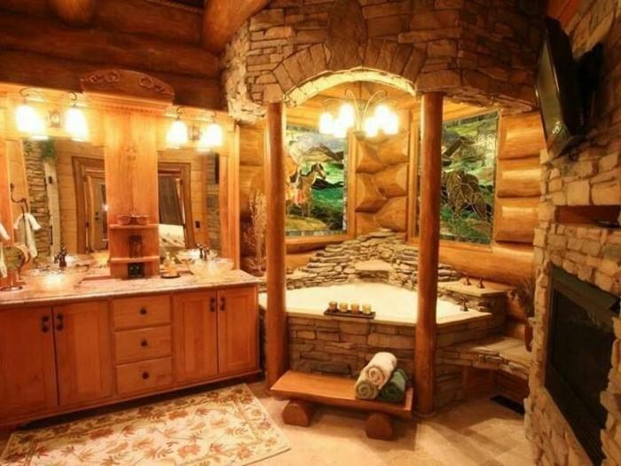 badgestaltung-ideen-einmalige-badewanne-aus-stein-gemütliche-beleuchtung