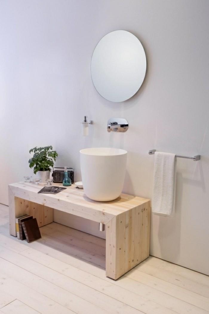 badgestaltung-ideen-runder-spiegel-hölzerne-möbel