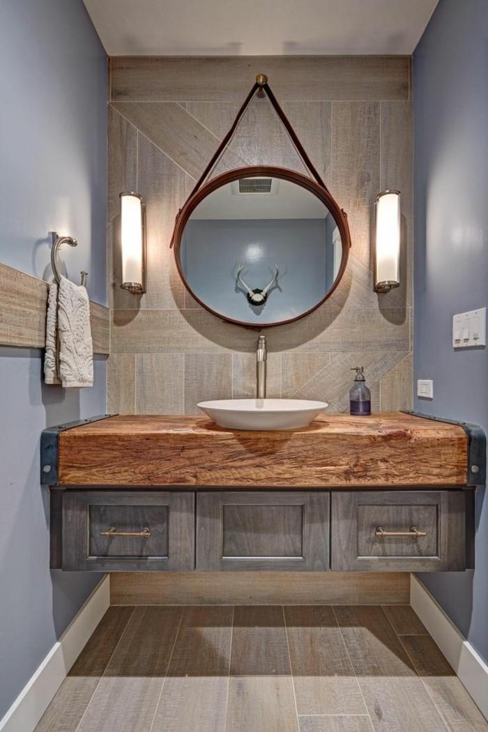 interessante-badezimmermöbel-runder-spiegel-an-der-hölzerne-wand