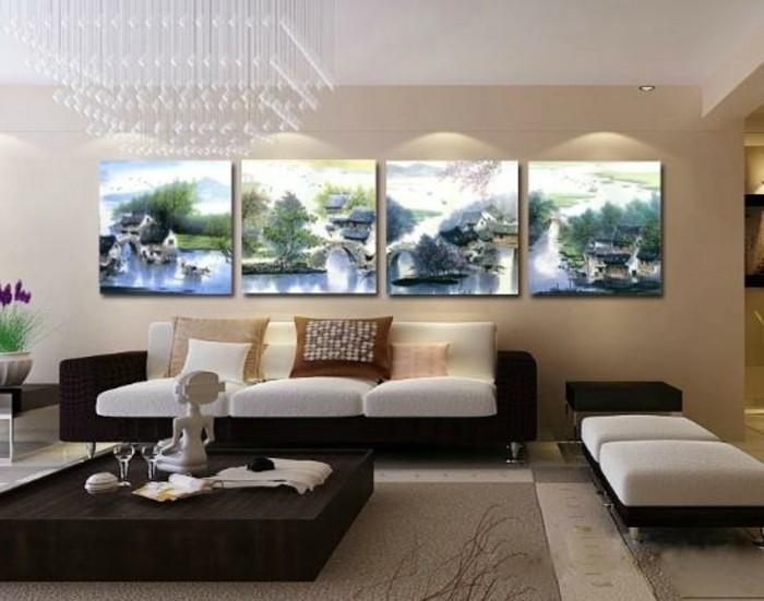 interessante-wohnzimmer-deko-bilder-an-der-beige-wand