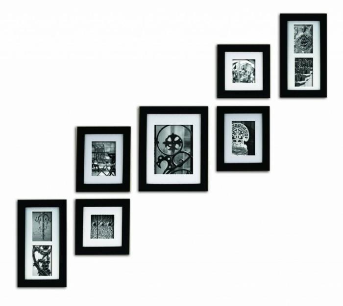 kreative-raumgestaltung-verschiedene-bilder-mit-schwarzen-rahmen-an-der-weißen-wand