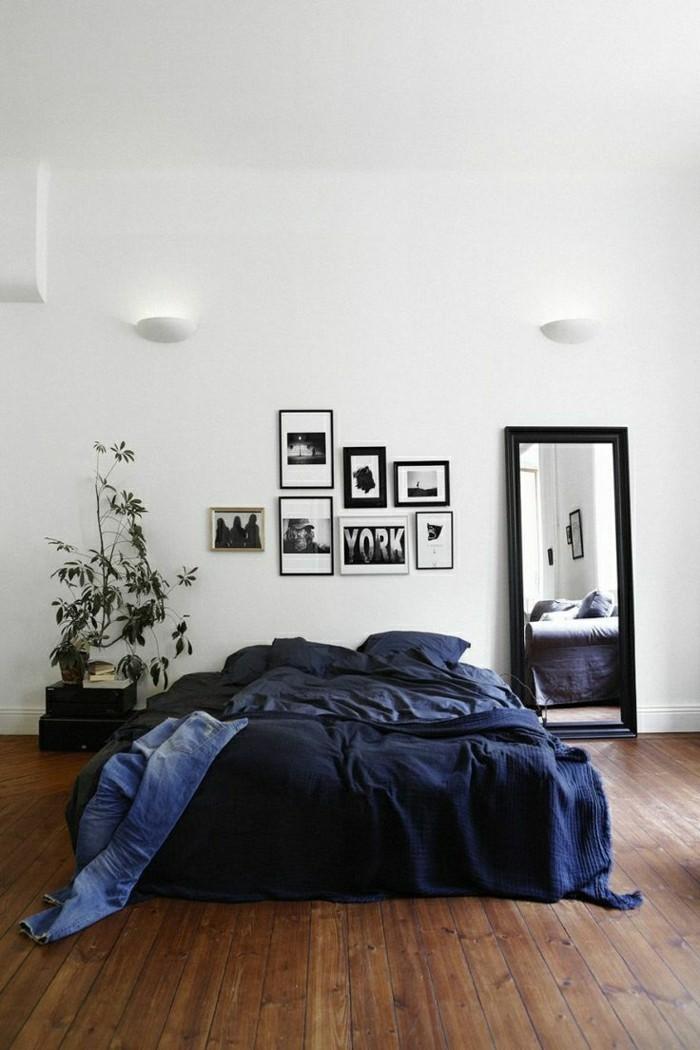 minimalistisches-Schlafzimmer-Interieur-mit-Holzparkett