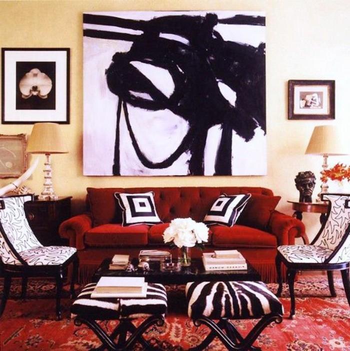 moderne-wohnung-extravagantes-schwarz-weißes-Wandbild-rote-Couch