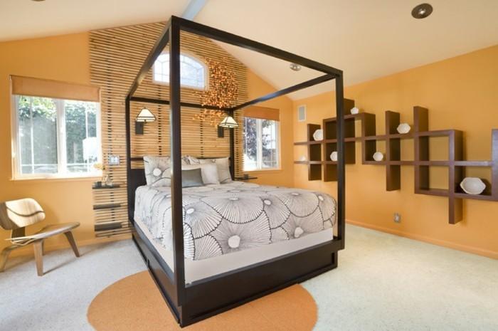 wandfarbe-gold-elegantes-und-bequemes-bett-im-tollen-schlafzimmer