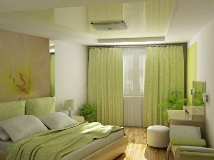 wandfarbe-grün-interessante-garderobe-kissen-auf-dem-bett-im-schlafzimmer