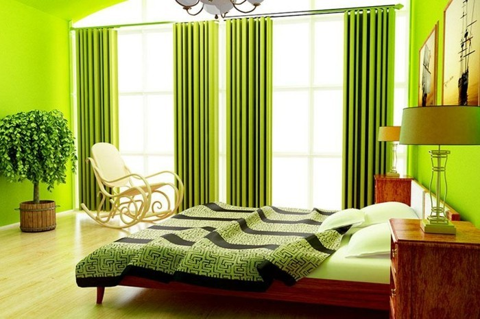 wandfarbe-grün-tolle-gardinen-und-bequemes-bett-im-schlafzimmer