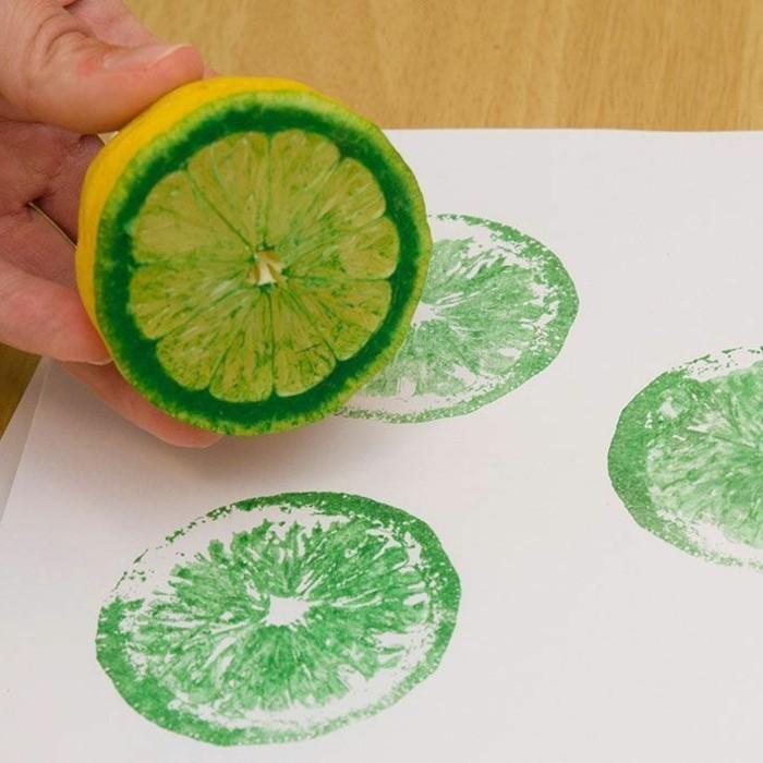 wandgestaltung-mit-farbe-zitronenscheiben-bemalung-grüne-farbe