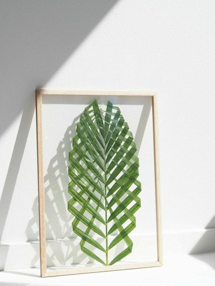 wandgestaltung-selber-machen-eine-figur-in-grün-wie-pflanzenblätter-aussehen