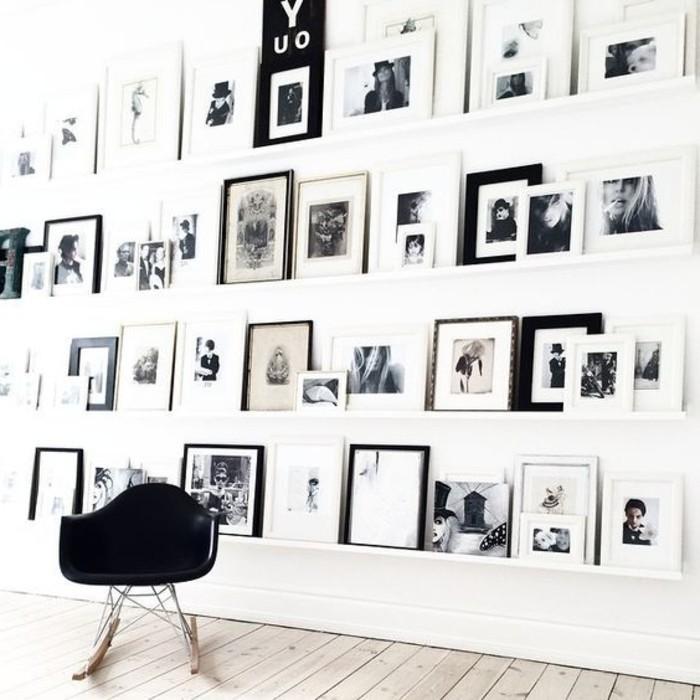cooler-Schaukel-Stuhl-in-einer-Art-Wohnung-mit-vielen-Wandbildern