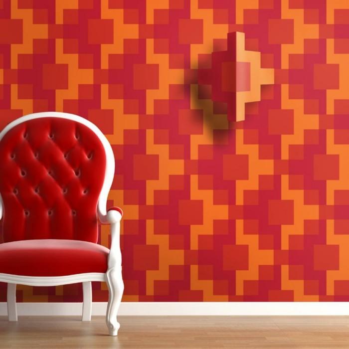 interessante-3d-tapete-in-rot-und-orange-roter-sessel-im-zimmer