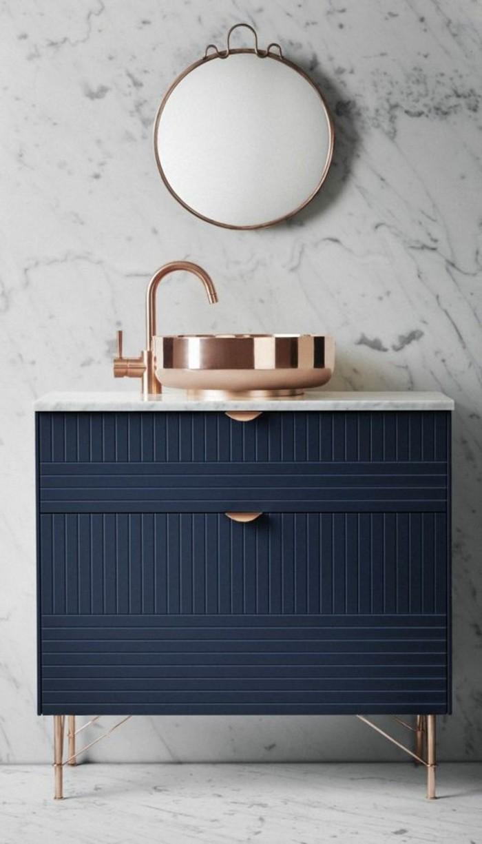 moderne-schöne-waschtischplatte-runder-spiegel-blaue-schubladen