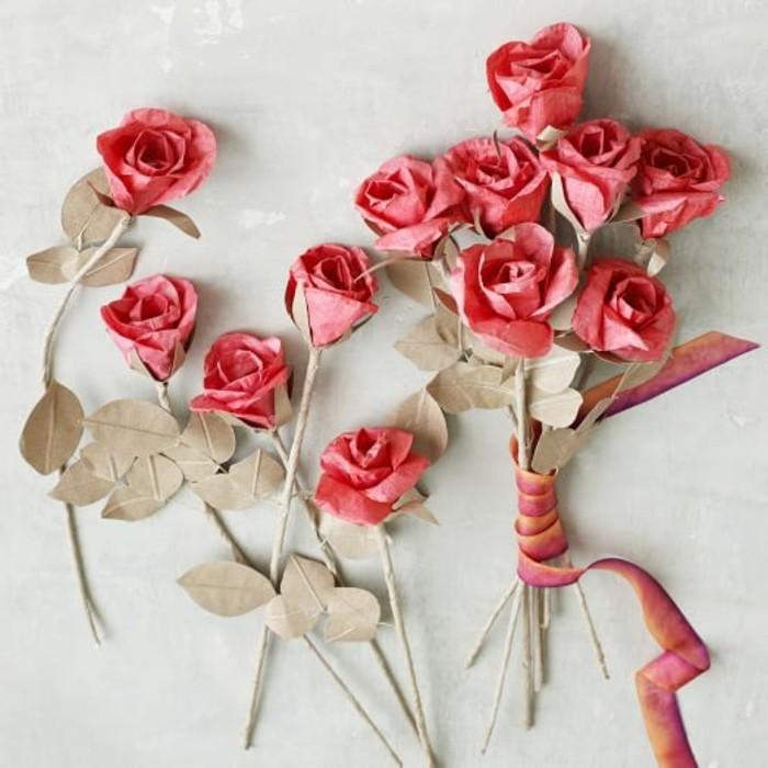 rote-rosen-aus-papier-selber-basteln-weiße-wand-dahinter