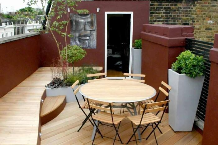runder-tisch-modernes-design-sitzbank-auf-der-kleinen-terrasse