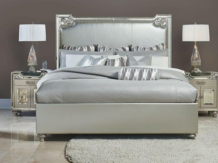 schickes-design-vom-schlafzimmer-polsterbett-mit-bettkasten-silberne-elemente