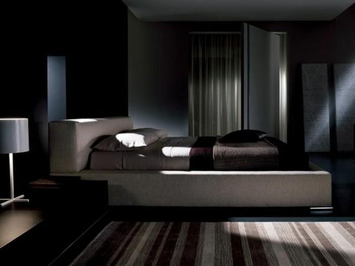 schwarzes-design-von-polsterbett-mit-bettkasten-schickes-interieur-im-schlafzimmer
