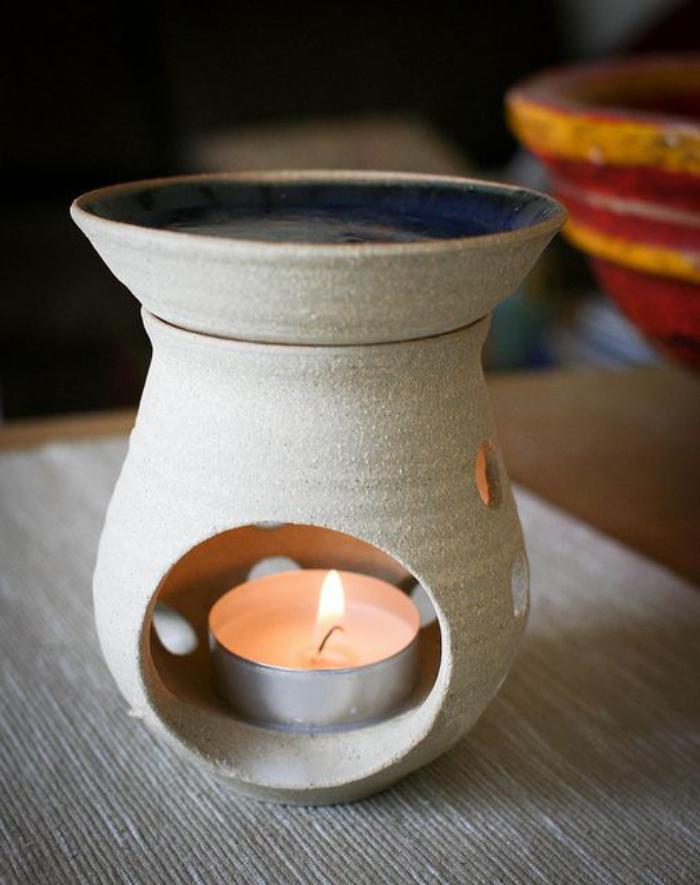 4-Duftkerzen-kleine-Teelichter-versteckt-in-Vase