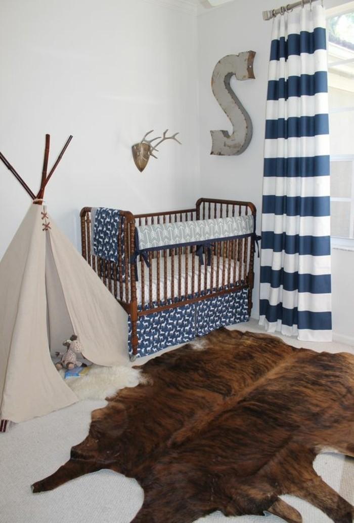 attraktives-modell-babyzimmer-mit-einem-teppich-kreatives-design-baby-bettchen
