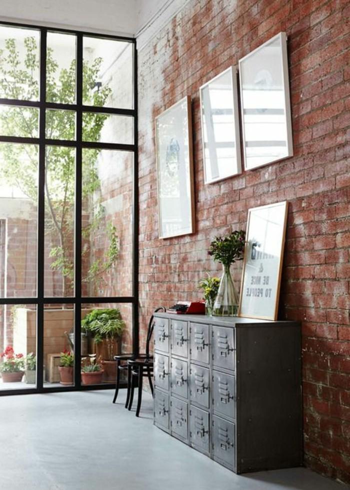 interessante-moderne-wohnzimmer-wandgestaltung-ziegelwand-bilder-daran