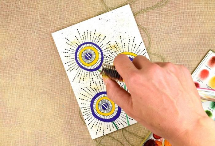 karten gestalten, weißes papier, große kreise, goldene akzente machen, buchstaben