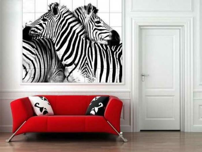 moderne-wandgestaltung-im-wohnzimmer-rotes-sofa-interessante-streichen-ideen