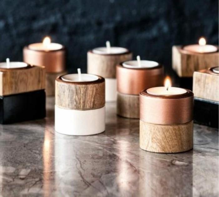 stilvolle-besondere-kerzen-im-Ständer-aus-Holz