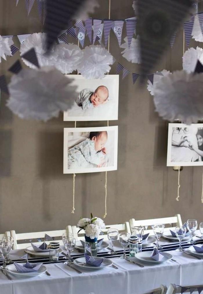 taufe-deko-interessante-hängende-bilder-von-babys-einmalige-tischdekoration
