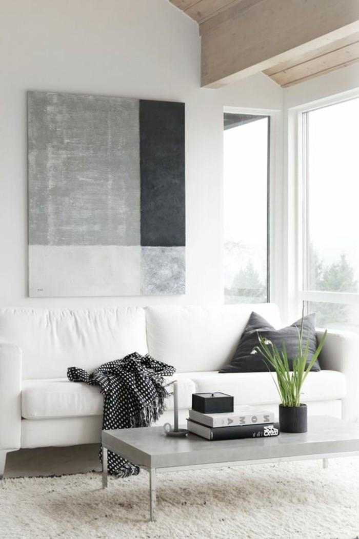 wunderschöne-attraktive-wohnzimmer-wandgestaltung-sehr-großes-bild-in-grauer-farbe-an-der-weißen-wand