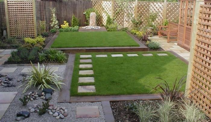 wunderschönes-design-vom-garten-grünes-gras-ziegelwand