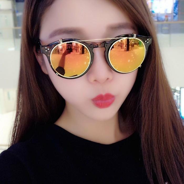 Verspiegelte-Sonnenbrille-mit-orangen-Gläsern