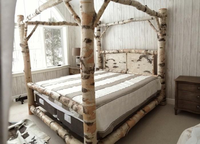 originelles-schlafzimmer-holzstamm-deko-fürs-schöne-große-bett