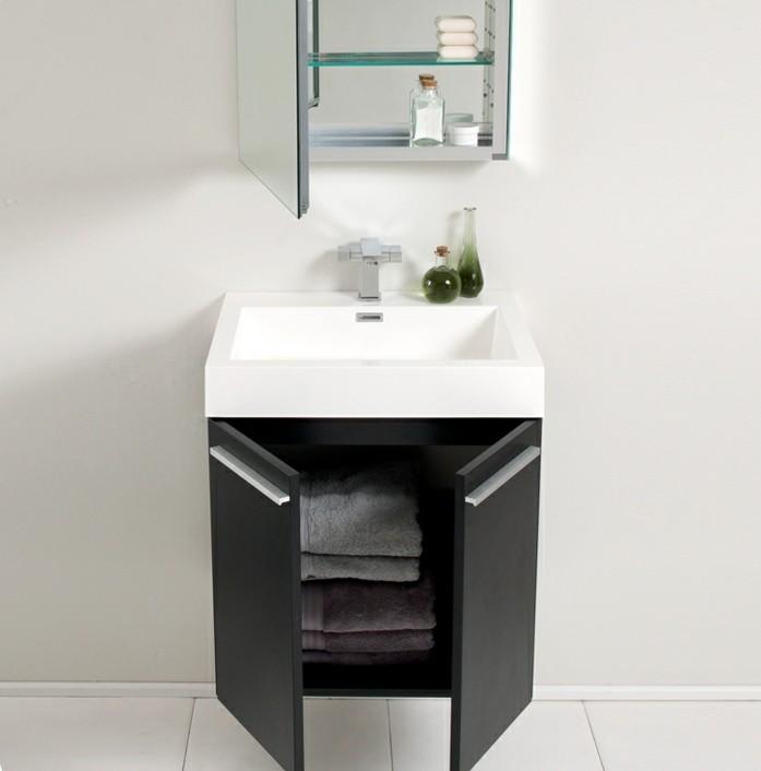 weißes-waschbecken-schwarzer-unterschrank-kleines-bad-einrichten