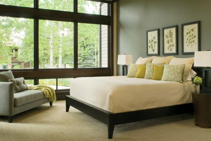 Wanddeko-Schlafzimmer-mit-Bildern-und-graue-Wandfarbe