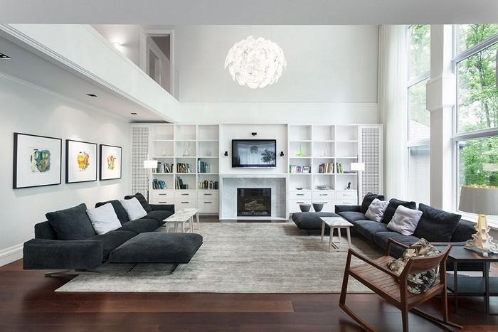Wohnzimmer-gestalten-das-moderne-Wohnzimmer-mit-einer-weissen-Lampe-und-schwarzen-Couchen