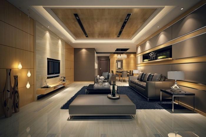 Wohnzimmer-gestalten-mit-einem-blauen-Tepich-und-einem-Fernseher