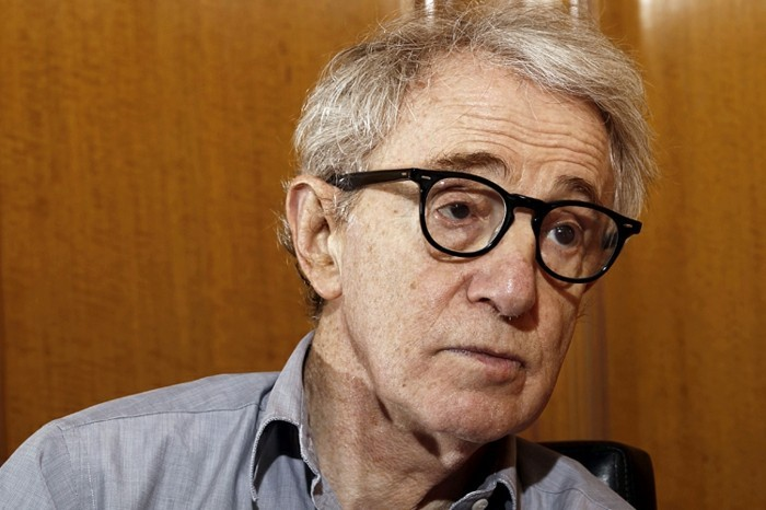 "FILE - In this Dec. 29, 2011 file photo, Woody Allen, director of the film, ""Midnight in Paris,"" is photographed during an interview in Beverly Hills, Calif. In nearly 45 years of alternating between toast of the town and yesterday's news, Allen has barely deviated from a simple formula: make a movie a year on an economical budget and avoid the show business baubles that distract from his routine. (AP Photo/Matt Sayles)"