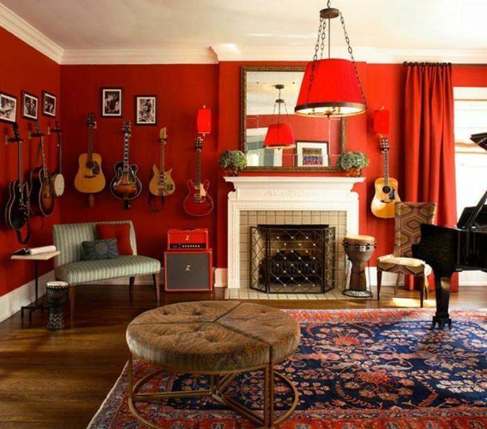 auffällige-wandfarben-ideen-wießer-kamin-rote-wände-im-wohnzimmer