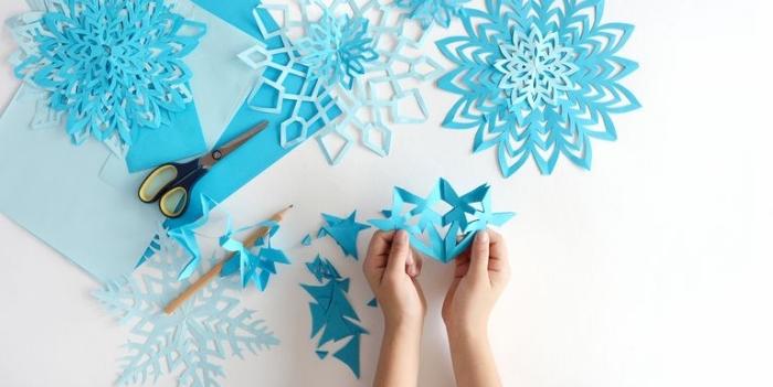 basteln weihnachten papier, schneeflocken ausschneiden, winterdeko ideen, winterdekoration