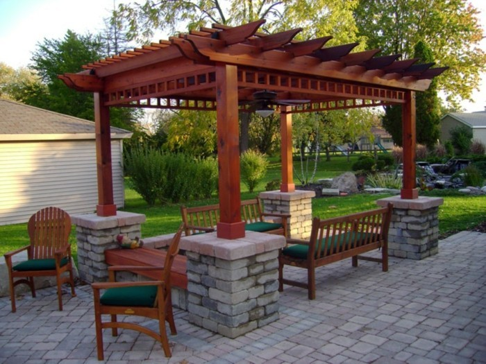 best-paving-material-idea-feat-beautiful-wooden-pergola-with-four-stone-base-design-plus-green-outdoor-seating-furniture-resized