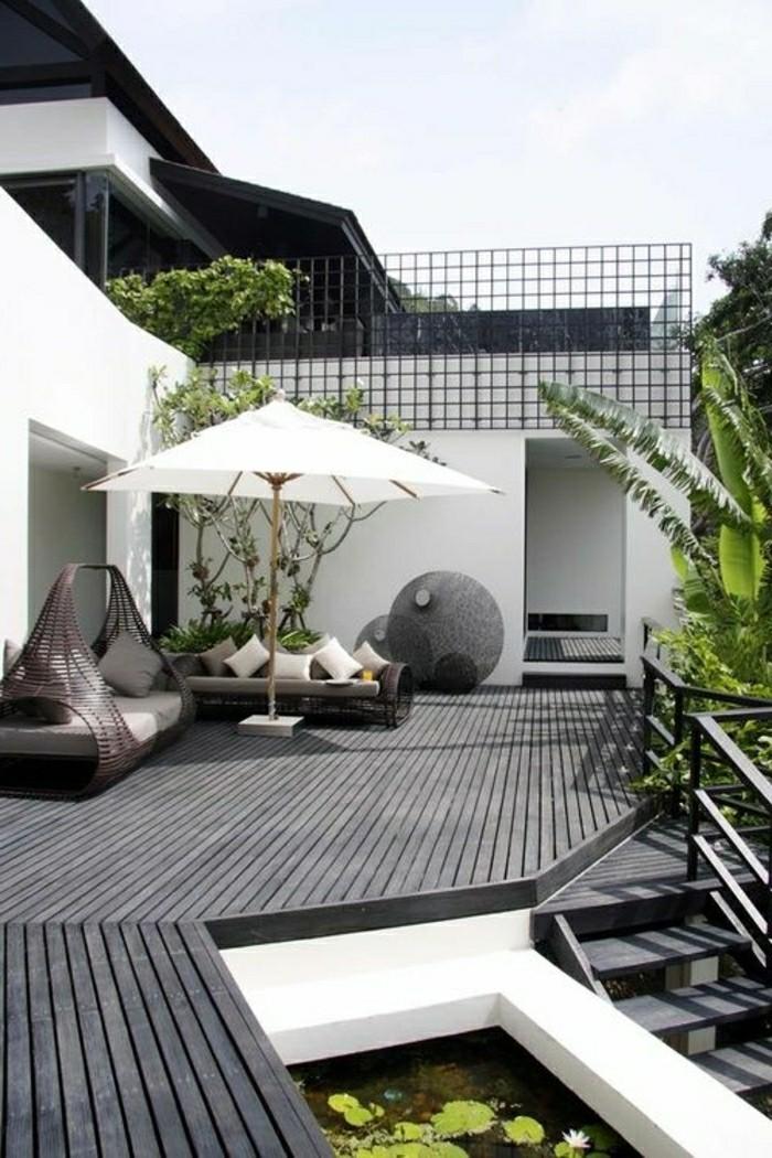 moderne-gartengestaltung-vorgarten-veranda-mit-holzbodenbelag