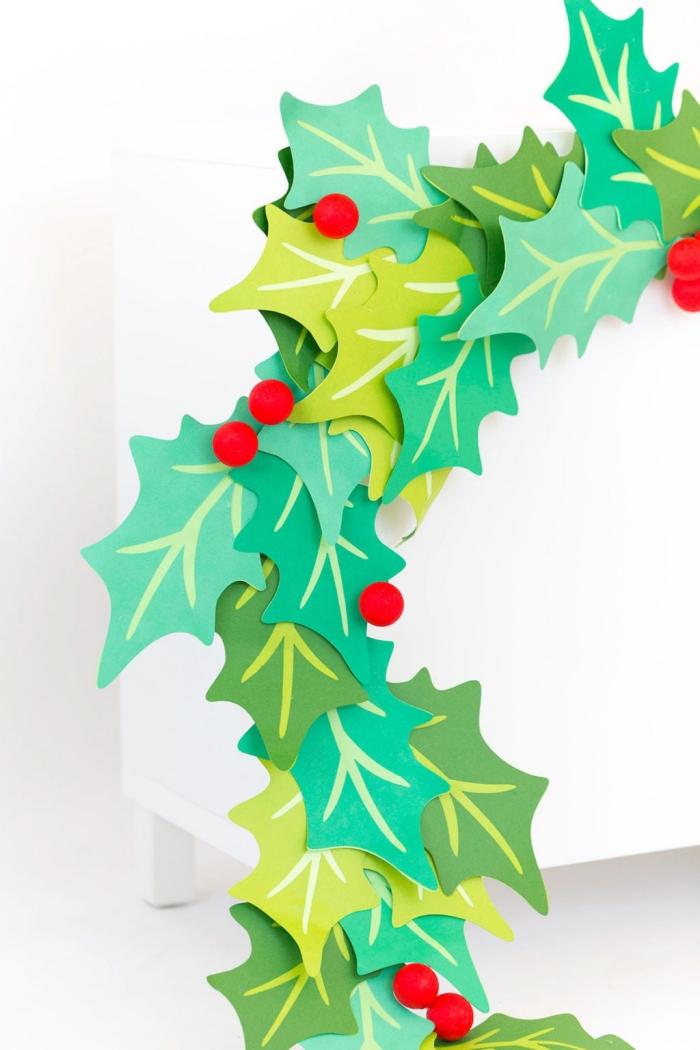 papier basteln, diy girlande aus cardstock, große grüne blätter, kleine rote bällchen